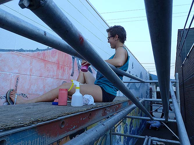 Volunteer hanging out painting on a cool evening.