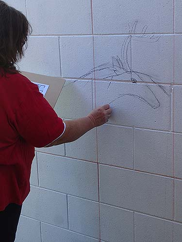 The drawings were scaled up on the wall using snapped chalk guidelines and charcoal.